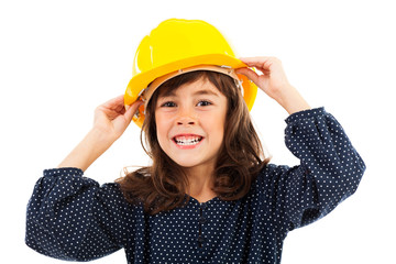 Beautiful little girl wearing construction helmet