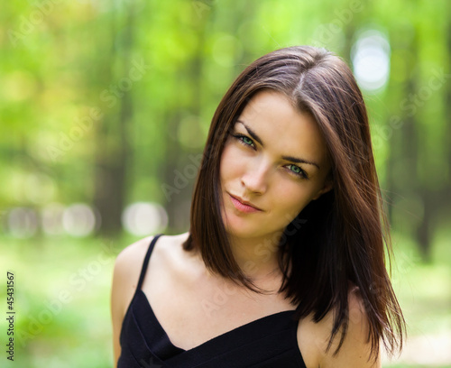 Beautiful suspicious woman in the forest