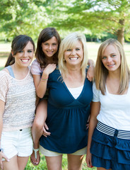 Mother and daughters outside