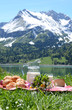 Milk, cheese and bread served in Alpine meadow, Switzerland