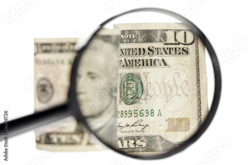 dollar and magnifying glass