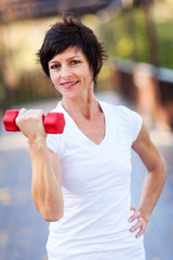 happy middle aged woman exercise with dumbbells