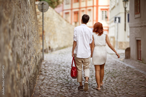 Young couple walking in old town of Prague