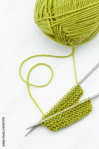 Green knitting wool and knitting needles