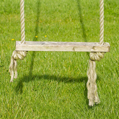 Old wooden tree swing