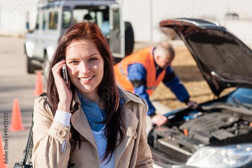 Deurstickers Woman talking on cellphone after car breakdown