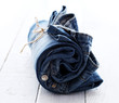 Jeans roll over wooden surface