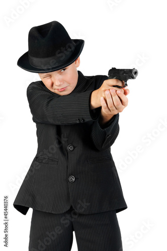 young gangster holding a gun and aim