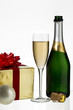 champagne flute and bottle with christmas gift