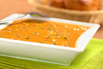Bowl of fresh homemade sweet potato soup with thyme