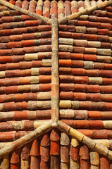 Hipped roof with red and antique shingles