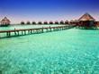 Island in ocean, overwater villas