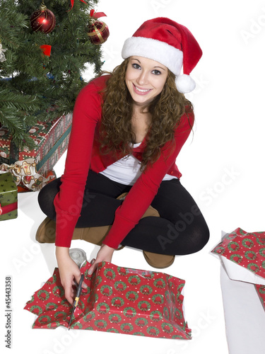 blonde lady cutting the gift wrapper