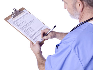 a male doctor with a medical clipboard writing