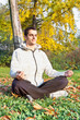 Young man has meditating in park