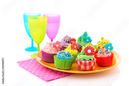 Colorful cupcakes with lemonade