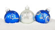 Christmas blue baubles on snow