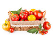 fresh tomatoes in the basket isolated on white background