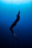Freediver moves out of the depth