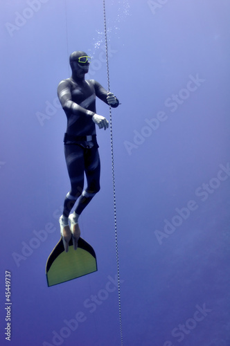 Freediver slowly surface