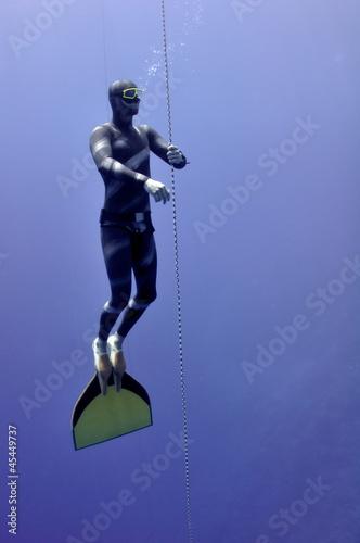 Freediver slowly surface