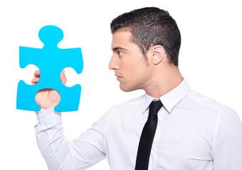 business concept homme avec puzzle bleu