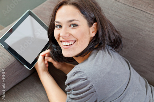Cute brunette and electronic tablet