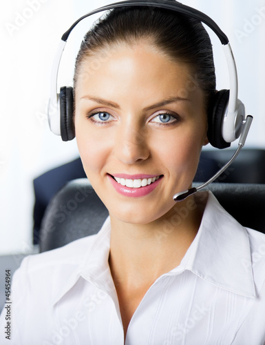 Portrait of female support phone operator at workplace