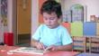 Preschool Student solwing puzzle