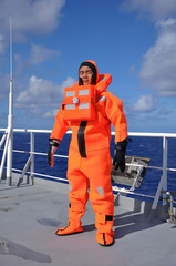 seaman in immersion suit and life jacket