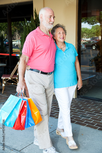 Happy Senior Couple Goes Shopping