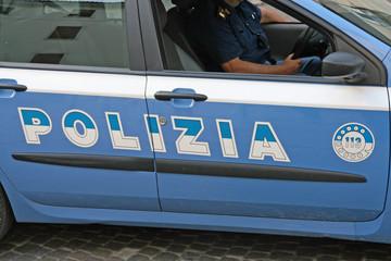 blue Italian police car with written Polizia