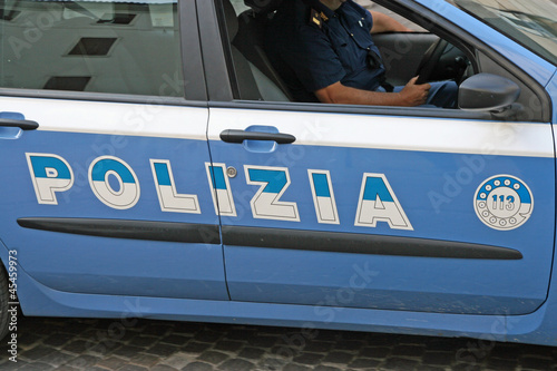 blue Italian police car with written Polizia