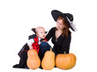 baby boy and mother in black halloween cloak