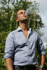 Man exhaling cigarette smoke