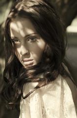 portrait of a beautiful brunette with sunspots