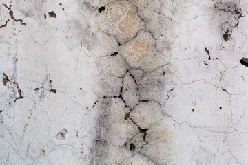 The gray concrete wall in the cracks  Abstract, close-up