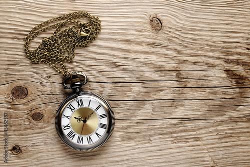 Antique watch on wooden background - 45462597