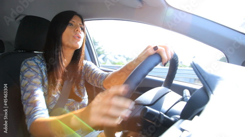 Beautiful woman singing happy driving car