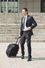 Young businessman with suitcase.