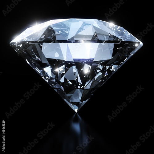 Leinwanddruck Bild Shiny diamond isolated on black background