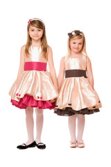 Two charming little girls in a dress