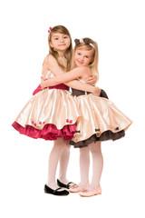 Two happy little girls in a dress