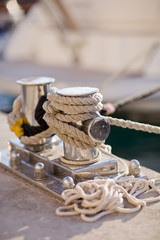 Sailboat detailed parts, close up on winch and rope of yacht