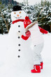 Winter fun, happy child making a snowman