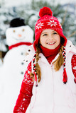 Winter fun, snowman and happy child