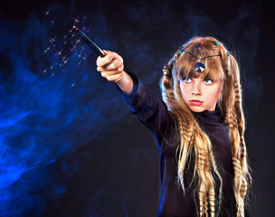 Girl  with magic wand casting spells.