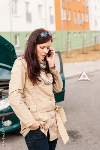 Woman on the phone for car help