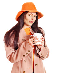 Woman wearing overcoat and hat.