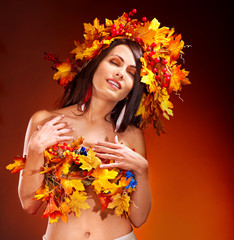 Girl with a wreath of autumn leaves on the head.